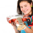 Girl holding an electric guitar — Stock Photo #7754336