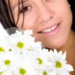 Beautiful girl with white flowers — Stock fotografie #7754337