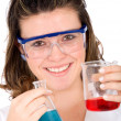 Female scientist with test tubes - Stock Photo