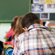 Kids in a primary school classroom - Stock Photo