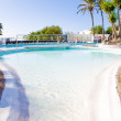 Swimming pool in a resort or villa - Stock Photo