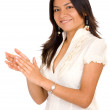 Business woman smiling and applauding - Stock Photo