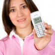 Woman in pink showing a mobile phone - Stock Photo