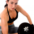 Foto Stock: Fit girl lifting lifting weights