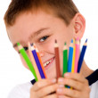 Stock Photo: Happy boy with color pencils