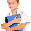Boy holding a blue notebook — Stok fotoğraf