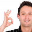 Casual guy giving the ok sign — Stock Photo