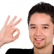 Young man doing the ok sign - Stock Photo