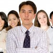 Confident business man and his business team — Stock Photo