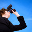 Stock Photo: Business vision - businesswoman over a blue sky