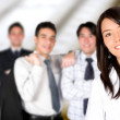 Stock Photo: Business team lead by a business woman