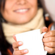 Casual girl holding a white mug — Stock Photo