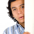 Curious guy peeking behind board — Stock Photo #7754889