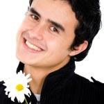 Man holding a daisy flower — Stock Photo