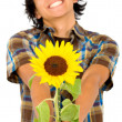 Happy man givng a sunflower — Stock Photo