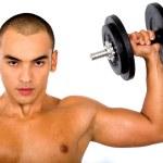 Muscular man lifting weights — Stock Photo
