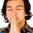 Casual man praying - Stock Photo