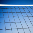 Beach volleyball net with a blue sky — Stock Photo