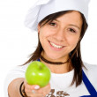 Female chef with an apple — Stok fotoğraf