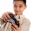 Stock Photo: Child playing video games
