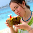 Stock Photo: Girl enjoying cocktail at beach