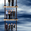 Corporate ladder - business team work — Stock Photo