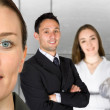 Beautiful business woman and her team - Stockfoto