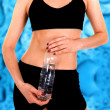Fit body with a water bottle — Stok fotoğraf