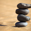 Balancing stones on a beach - Photo