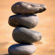 Balancing stones on a beach - Stock Photo