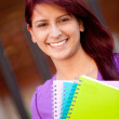 Female student smiling — Stock Photo