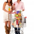 Stock Photo: Couple shopping groceries