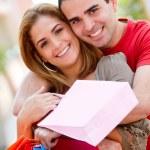 Shopping couple smiling — Stock Photo