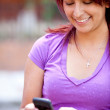 Stock Photo: Girl texting on the phone