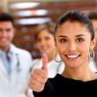 Patient with a group of doctors — Stock Photo #7755994