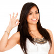 Woman making an ok sign with her hand - Stock Photo