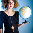 Stock Photo: Woman with a globe