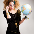 Woman with a globe — Stock Photo #7756169