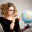 Woman with a globe — Stok fotoğraf
