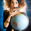 Woman with a globe - Foto Stock