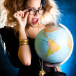 Woman with a globe — Stock fotografie