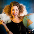Rich woman with a globe - Stock Photo