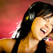 Woman listening to music - Stok fotoğraf