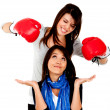 Woman getting punched - Stock Photo