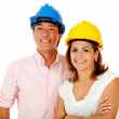 Architects with helmets — Stock Photo