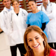 Patient with a group of doctors — Stock Photo #7756939