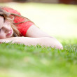Girl lying outdoors — Stock fotografie