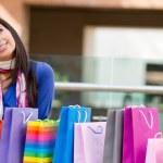 Thoughtful shopping woman — Stock Photo #7757055
