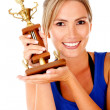 Woman with trophy — Stock Photo #7757431