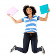 Female student jumping — Stock Photo